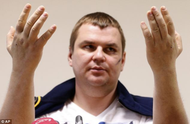 Bulatov said his captors forced him to admit he was a US spy. He said: 'I was telling them lies just to stop the torture'