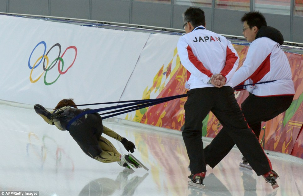 Hard to pull off: A Japanese speed skater trains with her team as the eyes of the world rest on the Black Sea resort