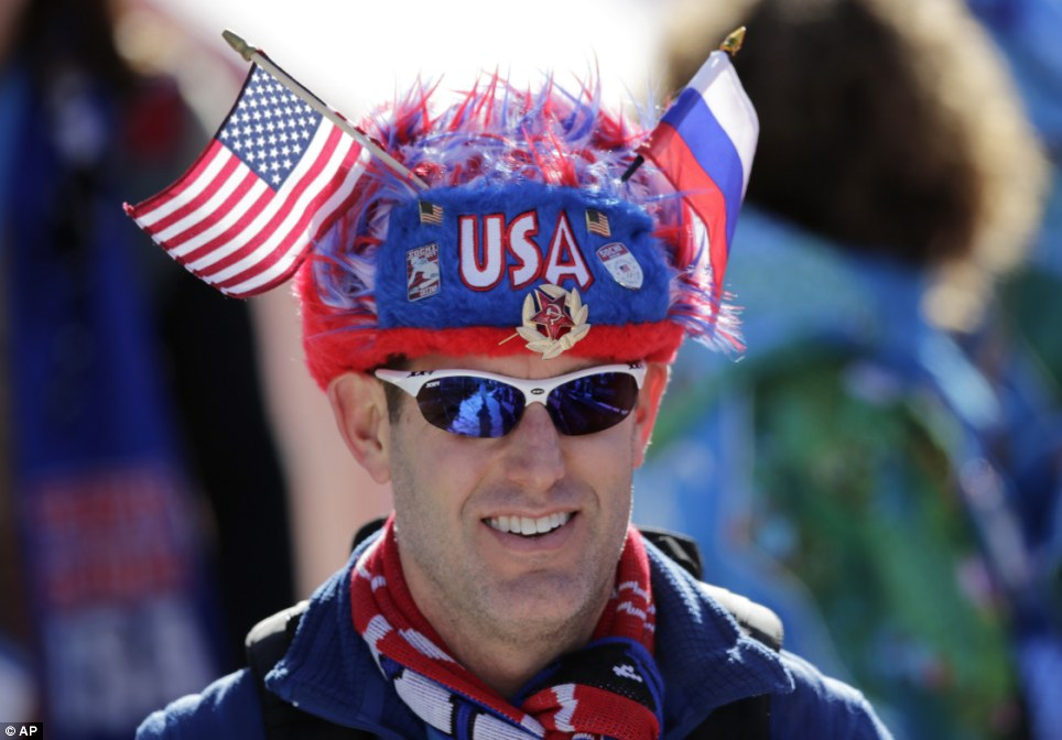Fans arriving: A United States spectator wears a fuzzy hat decorated with the U.S. and Russian flags, as well as the Communist hammer and sickle during men's and women's downhill practice