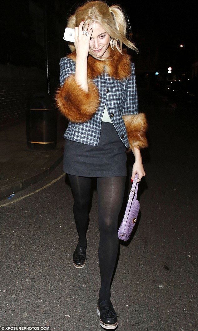 Pixie Lott Sports Cute Fur Trim Jacket And Bunches For