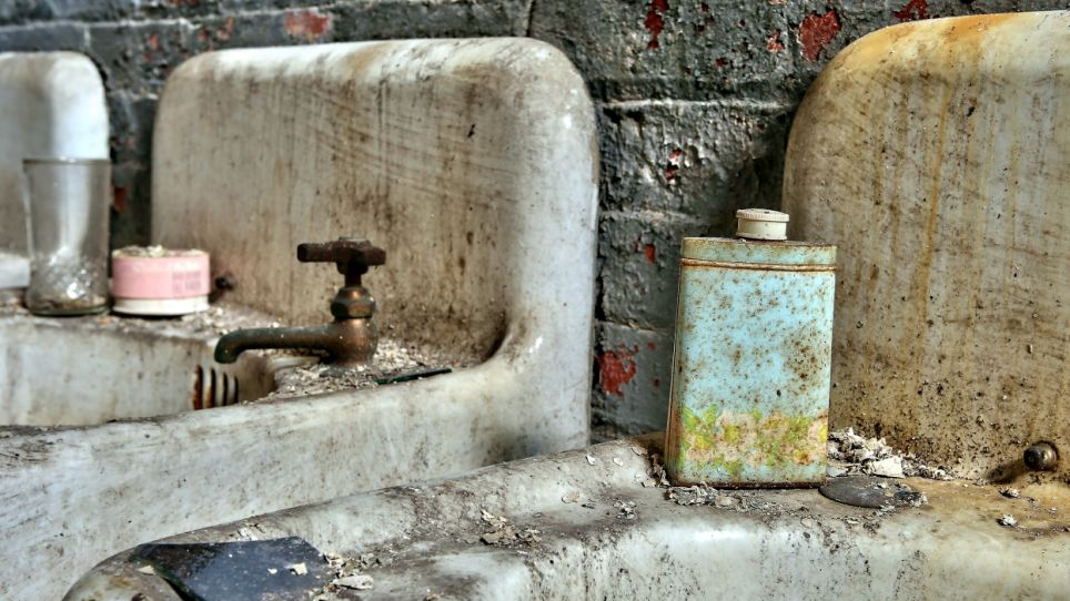 Hygiene: A bottle sits on a sink in one of the factory's toilets. 50 years ago the mill would have been full of activity, with employees going about their daily tasks