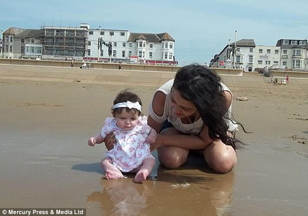Holiday: Ava-Jayne with her mother playing on the beach in a family photo uploaded to Facebook