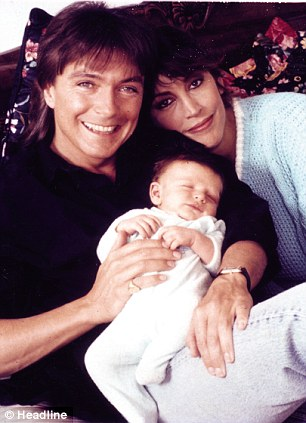 Happier times: David and Sue with their baby son Beau in 1991
