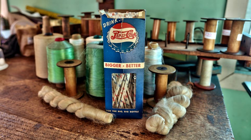 Make do and mend: This battered carton contains Pepsi straws for 'the big, big bottle' and had only just been opened when the factory shut its doors for the final time in 1957