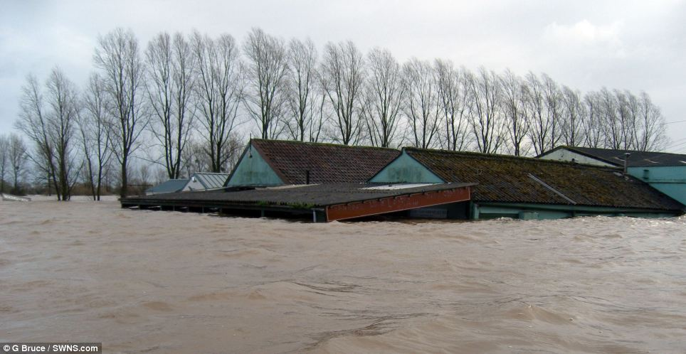 Biblical: The road side store and workshop on the A361 near East Lyng in Somerset is completely flooded with water levels reaching seven foot, completely swamping the surrounding area