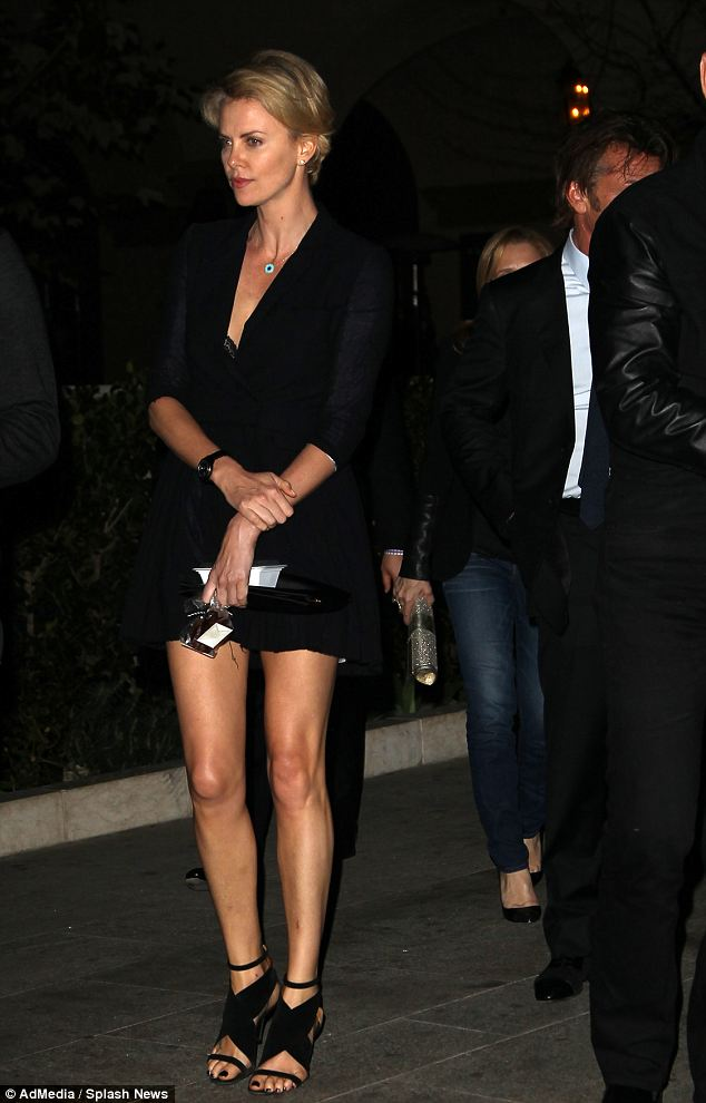 Charlize Theron Wows In Little Black Dress On Dinner Date