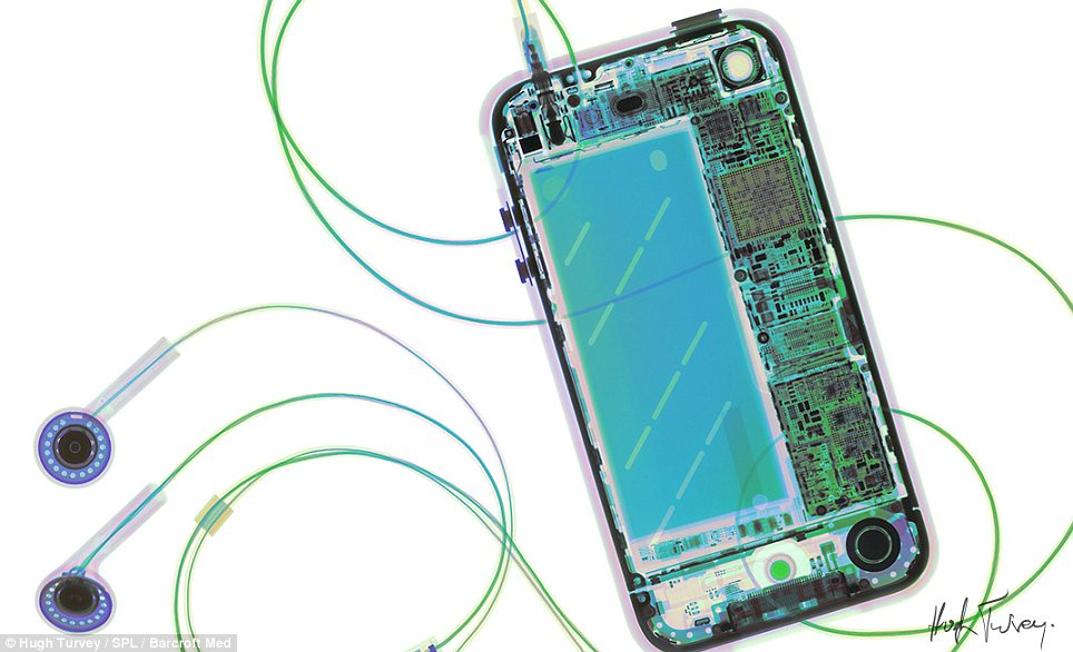 Everyday miracle: Mr Turvey's belief that X-rays 'reveal a deeper understanding' is certainly true when applied to the iPhone, the processor, camera and battery of which can be seen here