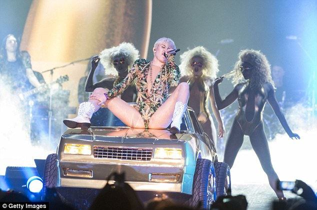 Belting it out: Miley crooned as she backup performers swayed behind her