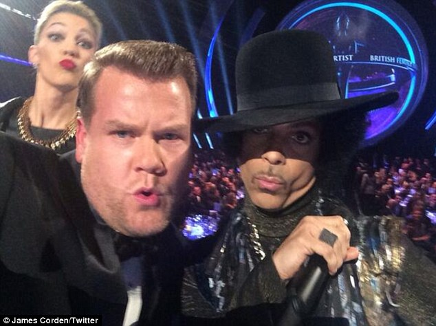 Now that's a selfie: The presenter poses with pol; legend Prince and 3RDEYEGIRL
