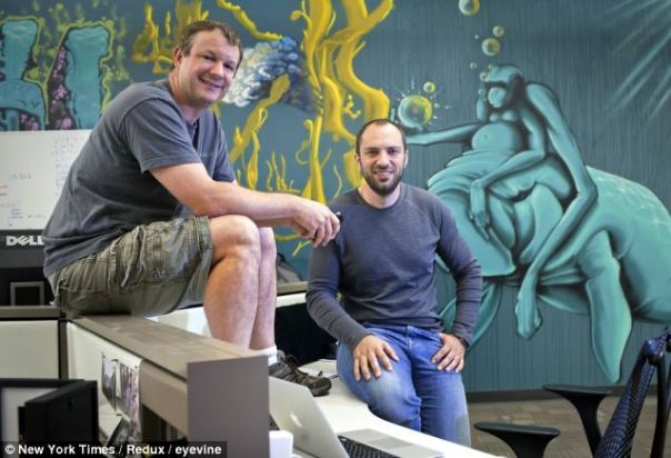 $19 billion richer this morning: Brian Acton (left) and Jan Koum at Whatsapp's family headquarters in Mountain View California last May