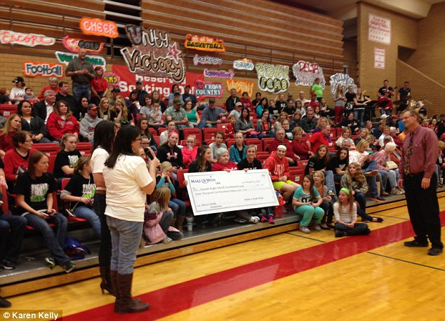 Make-A-Wish presented Jayci Glover's $7,500 check to Kanab High School before a basketball game on February 12