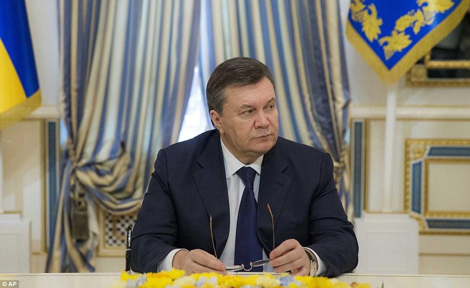 Tổng thống bị lật đổ có vẻ bị đánh bại như ông chờ đợi để ký thỏa thuận nhằm chấm dứt bạo lực mà đã nhấn chìm thủ đô Ukraina