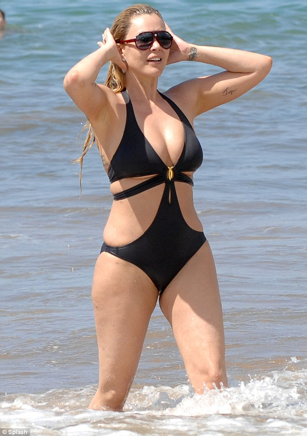 Sexy swimwear: The ex-wife of Travis Barker and former partner of Oscar De La Hoya flaunted her figure in a sexy black monokini
