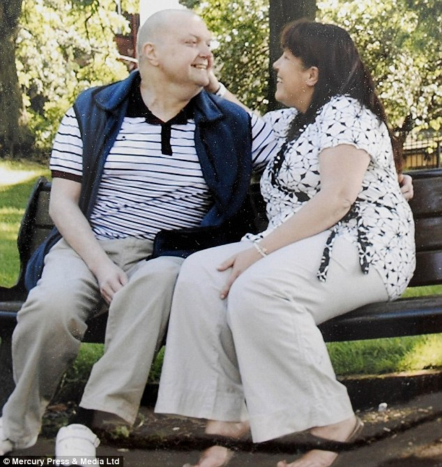 Mr Brooks with his partner Rose. He said: 'It feels like I've got someone watching over me because after all of the treatment and tumours I've had, I'm still here'
