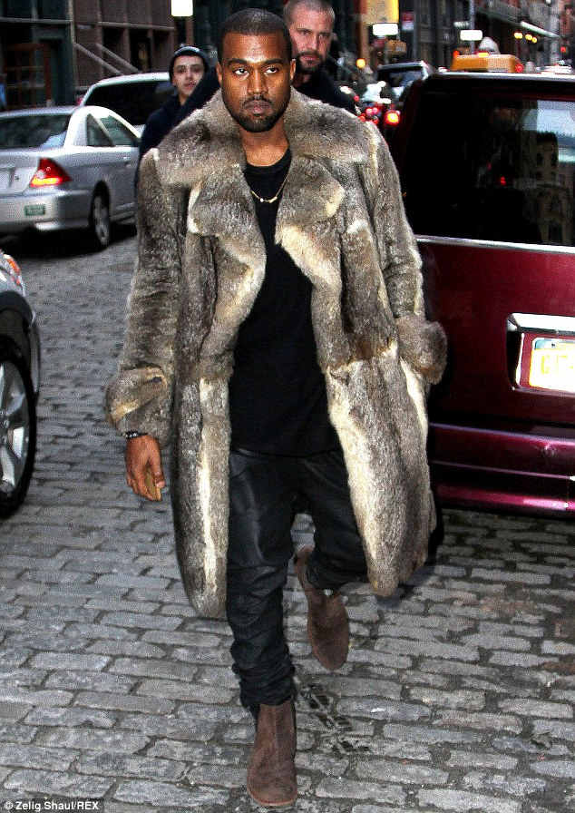 Moody mister: The rap artist was stylish but in no mood for fanfare as he emerged on Sunday in New York while wearing a fur coat