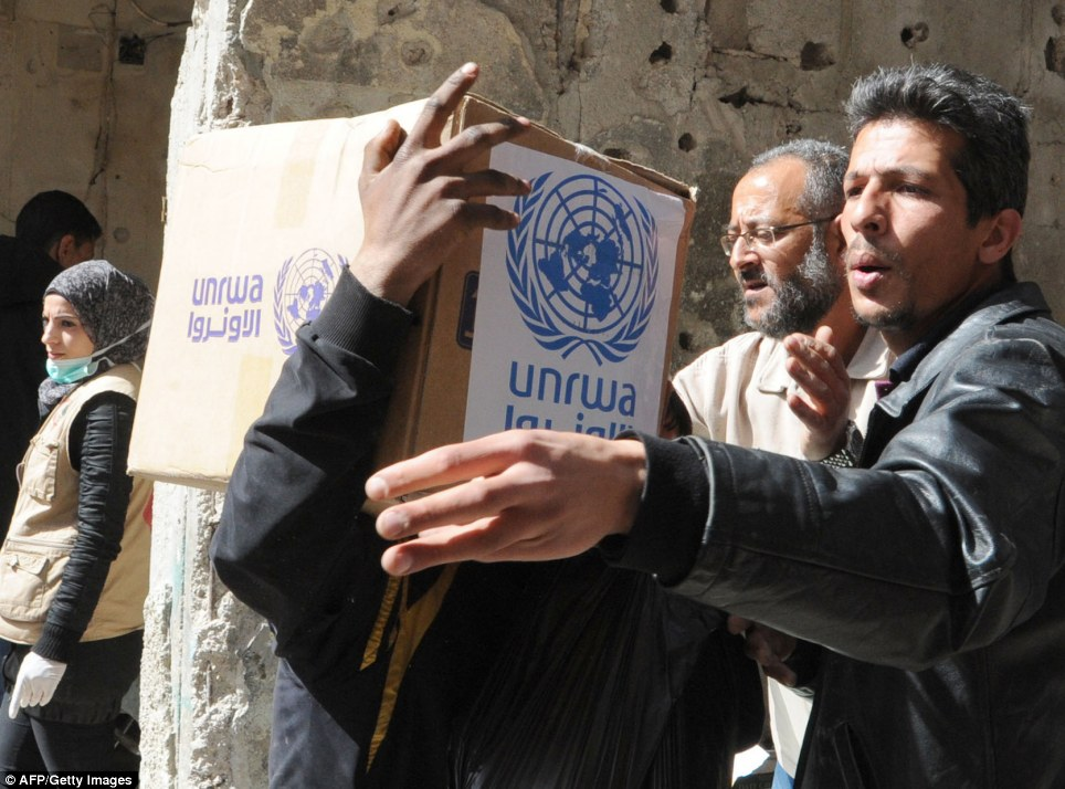 Saviours: Staff from the UN agency for Palestinian refugees UNRWA has resumed distribution of desperately needed food and medicine