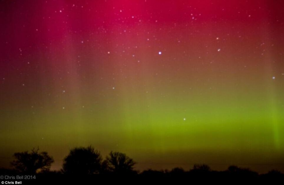 Different colours: Stargazers in Foxley, Norfolk, were treated to a stunning display of the Aurora Borealis that lit up the sky last night