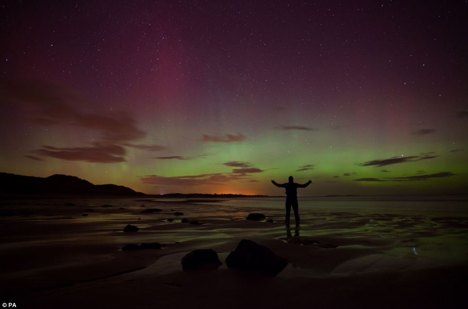 Colourful: The bay was lit up with purple, blue and green colours as millions of particles entered the earth's atmosphere