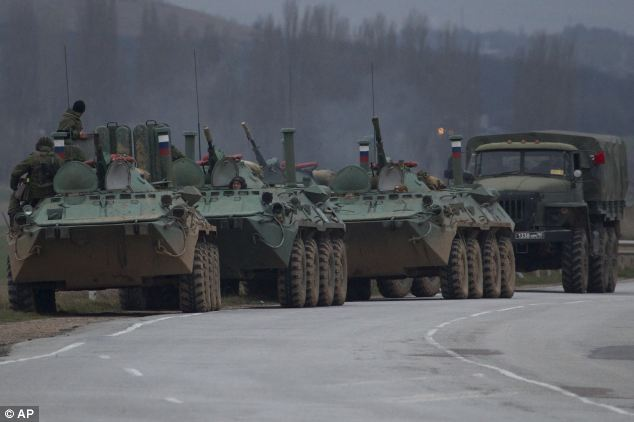 University of California experts showed that location-tagged tweets by Ukraine residents could have been used to map out sentiments towards Russia in real-time. Pictured, Russian armoured personnel carriers and a truck seen on a road near the town of Bakhchisarai in 2014