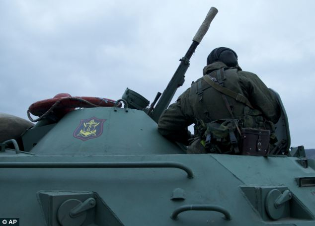 A solider on board a Russian armoured personnel carrier, one of a convoy of up to nine vehicles which was spotted on the move in the Ukraine, around 20 miles from Sebastapol on Friday.
