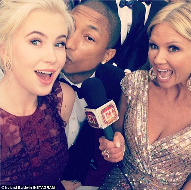 Making them jealous: Ireland will be the envy of her friends after being smooched by hunk Pharrell Williams