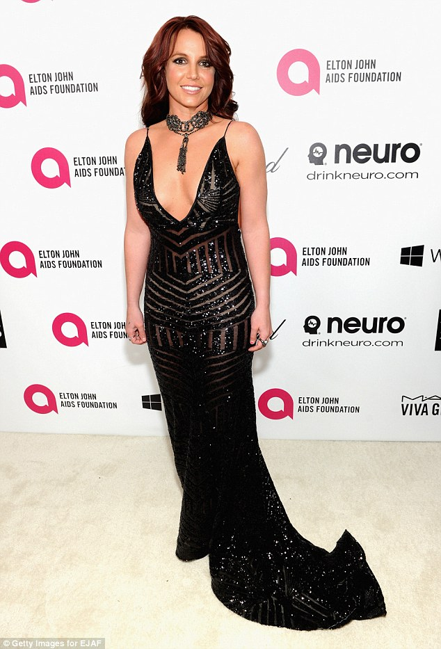 Well hello there! Britney Spears glammed up for the 22nd Annual Elton John AIDS Foundation Academy Awards Viewing Party in a plunging and sheer dress