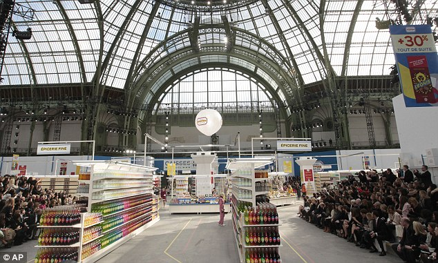 Supermarket sweep: The runway for the show was set up like a supermarket, with the models perusing the aisles before walking the catwalk with baskets and trolleys