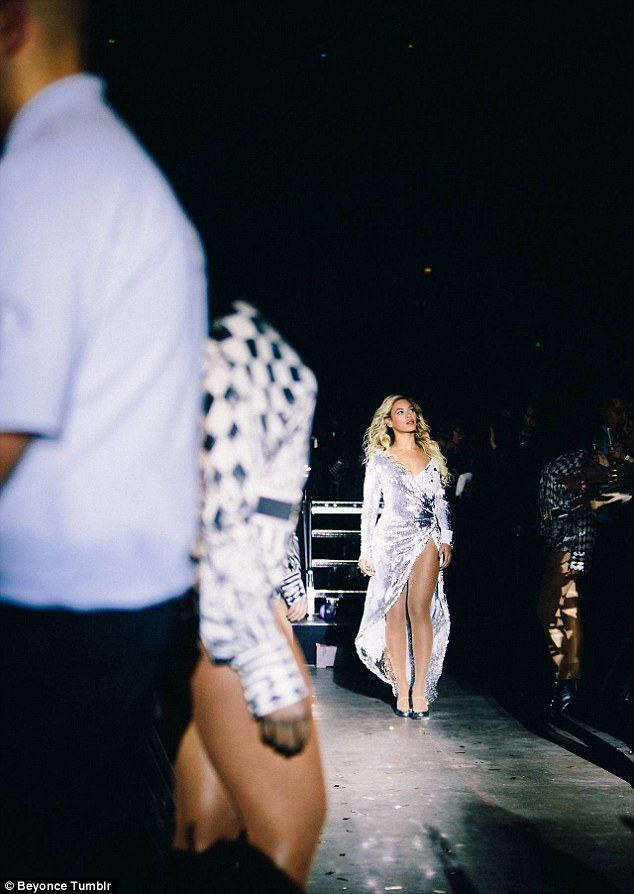 Life on the road: Beyonce seen during her show in a gorgeous silver dress