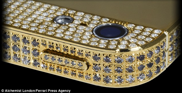 The handset, built by London based jewellers Alchemist, is the world's most expensive iPhone - with a £600,000 ($1 million) price tag. Dubbed Million Dollar iPhone, the handset has a handmade, 24-carat gold bezel and is covered in 700 individual diamonds, totalling over seven carats