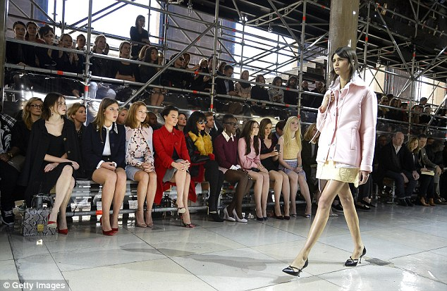 In style: A model struts past the famous front row at the Miu Miu show