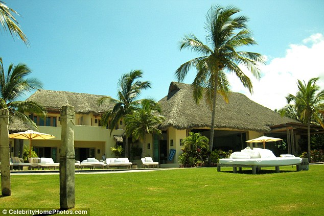 Picture-perfect: The couple are said to be eyeing up close friend Joe Francis' luxury five-star property in Punta Mita, Mexico - where they vacationed as a family in January - for their intimate nuptials