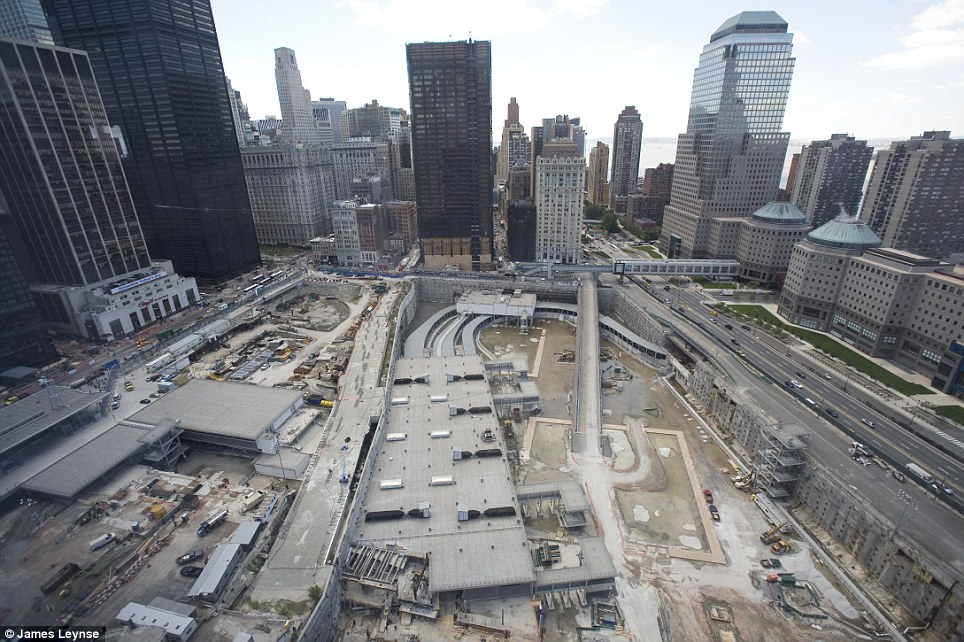 Clean up, recovery and construction: This is the World Trade Center development site seen from the newly opened 7 World Trade Center in 2006 as work on the huge foundations of One World Trade Center began unseen by the public hundreds of feet below ground