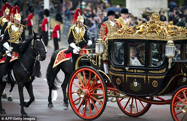 Queen Elizabeth II and Prince Phillip ride in the Asutralian State Coach accompanied by members of the Household Cavalry after the State Opening of Parliament in London, in 2012