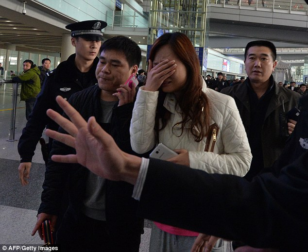 Grief: Family and friends waiting for the plane to arrive break down as they hear the jet has gone missing. The flight vanished off the coast of Vietnam around two hours after taking off