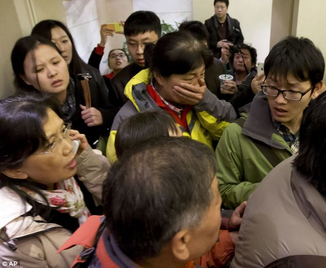 Desperate: Relatives waiting for news have been booked into a hotel at Beijing Airport