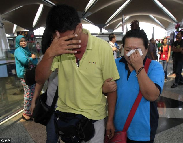 Anxious: Families of those on board the Malaysia Airlines Flight MH307 from Kuala Lumpur to Beijing, face an anxious wait for news of the search mission at Kuala Lumpur airport