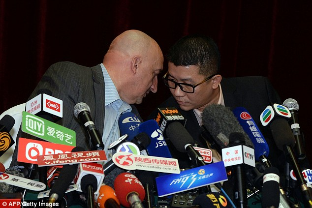 Malaysian Airlines senior official Dr Hugh Dunleavy, left, speaks to Ignatius Ong, from the airline's crisis management team, in Beijing on Saturday