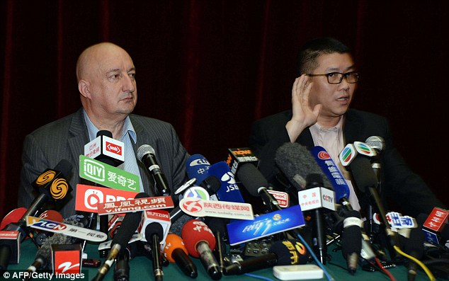 Hugh Dunleavy, left, and Ignatius Ong, right, of Malaysian Airlines, answer questions at a press conference