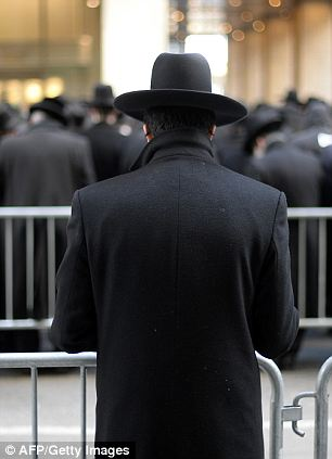 Thousands of Orthodox Jews gather on Water Street in lower Manhattan March 9, 2014 to pray and protest against the current effort by the Israeli government to pass a law to draft religious Jews into its army. The gathering is intended as a show of solidarity with the Orthodox Jews in the State of Israel, who gathered last Sunday at the entrance of Jerusalem in the what some have called the largest protest of its kind in recent history. Most estimated the crowd there at over 600,000 men, women and children. AFP PHOTO / Timothy A. CLARYTIMOTHY A. CLARY/AFP/Getty Images
