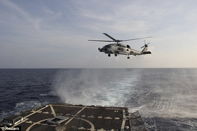 Search: A U.S. Navy SH-60R Seahawk helicopter takes off from the destroyer USS Pinckney in the Gulf of Thailand, to assist in the search for missing Malaysian Airlines flight MH370 on Monday