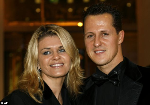 Anxious wait: Formula One champion Michael Schumacher of Germany poses with his wife Corinna at the 2006 FIA Awards Ceremony, in Monaco