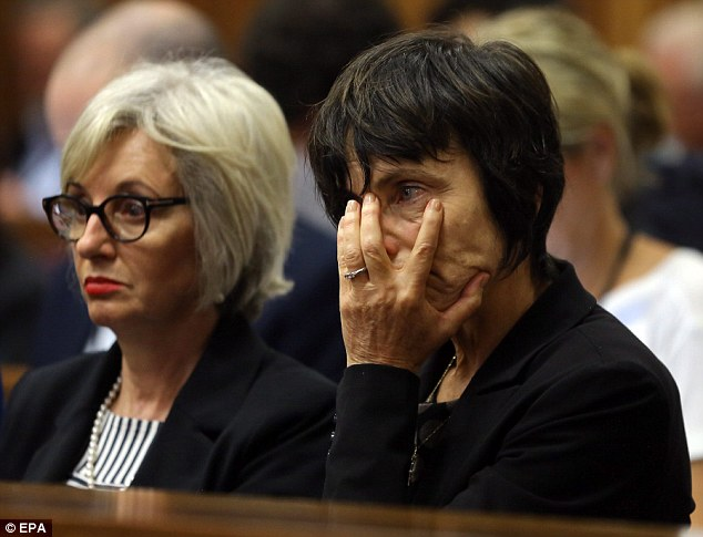 Shock: A member of Pistorius's family (pictured, right, next to his aunt Lois) covers her mouth as distressing details of Miss Steenkamp's death are revealed in court