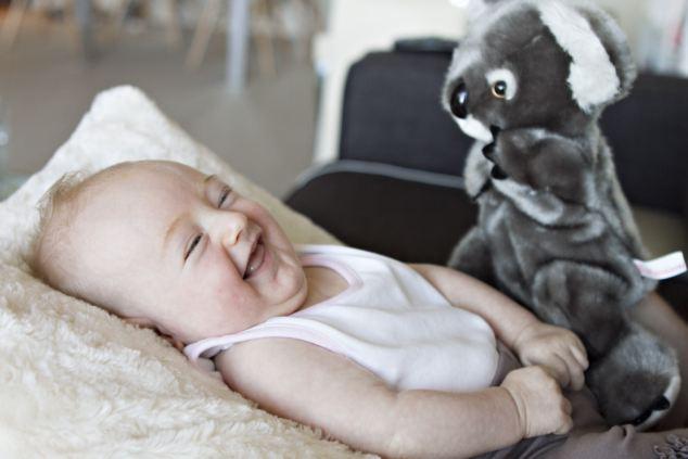 Three-month-old Sienna loves her puppet toy