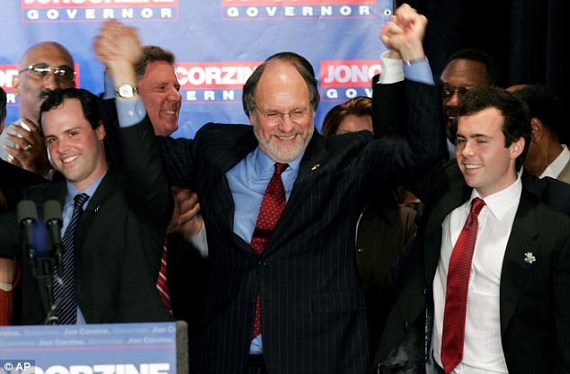 Jeffrey Corzine is seen at his father's side (right) when he was elected to be the governor of New Jersey in November 2005. His brother, Josh, is also pictured raising his father's hand in victory (left).
