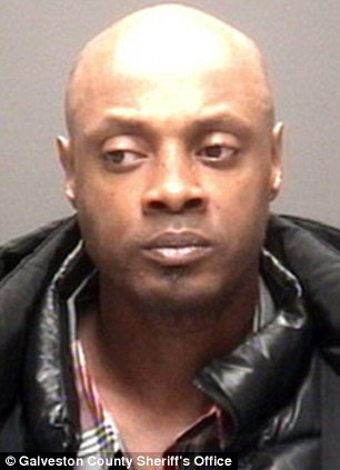 Collared: James Cosby, 46, has been arrested on charges of tampering with evidence in the killings of his daughter and her girlfriend, both 24, last week