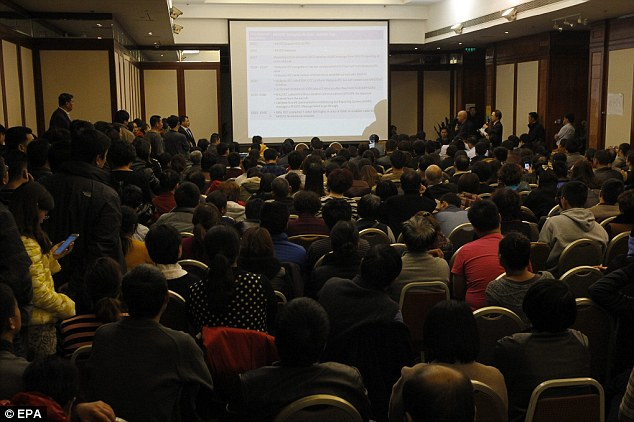 Wanting answers: Relatives of passengers of a missing Malaysia Airlines plane attend a conference with airline representatives at a hotel in Beijing, China on Saturday