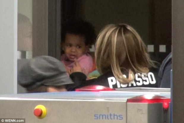 Mother-daughter time: Bey cooed over her two-year-old daughter as they left the bustling room