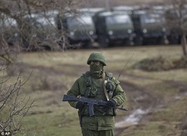 Russian troops: Meanwhile, Crimea's parliament today declared the region an independent state, after its residents voted overwhelmingly to break off from Ukraine and seek to join Russia (pictured: A Russian soldier in Crimea)