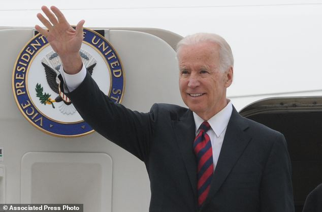 U.S. Vice President Joe Biden waves as he arrives at the Okecie military airport in Warsaw, Poland