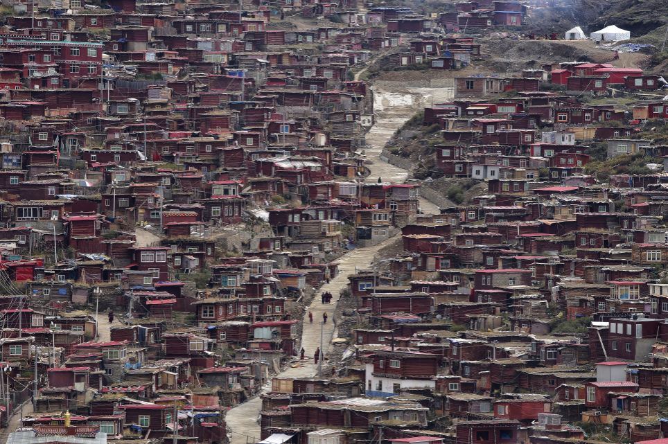Houses: Having rapidly grown to become one of the most important and largest Tibetan schools, the surrounding hillside is now home to the studying monks